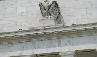 FILE - This May 4, 2021 file photo shows the Federal Reserve building in Washington.  The Federal Reserve said Thursday, Sept. 16,  that it is reviewing its ethics policies governing senior officials' financial holdings, in the wake of disclosures that two regional Fed presidents engaged in extensive trading last year.  (AP Photo/Patrick Semansky, File)