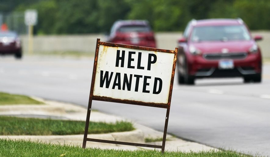 In this Tuesday, July 27, 2021, file photo, a help-wanted sign is displayed at a gas station in Mount Prospect, Ill. The gulf between record job openings and a lack of people taking those jobs is forcing Wall Street to reassess the pace of the economic recovery. (AP Photo/Nam Y. Huh, File)