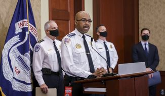 """Washington Metropolitan Police Chief of Police Robert Contee, center, is joined by U.S. Capitol Police Chief Tom Manger, left, and others during a news conference to discuss preparations for a weekend rally planned by allies of Donald Trump who support the so-called """"political prisoners"""" of the Jan. 6 attack on the Capitol, Friday, Sept. 17, 2021, at the Capitol in Washington, (AP Photo/J. Scott Applewhite)"""