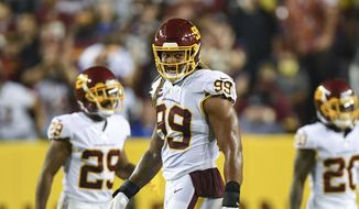 Washington Football Team defensive end Chase Young (99) looks on between plays during the second half of an NFL football game against the New York Giants, Thursday, Sept. 16, 2021, in Landover, Md. (AP Photo/Terrance Williams) **FILE**