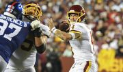 Washington Football Team quarterback Taylor Heinicke (4) looks to pass the ball during the first half of an NFL football game against the New York Giants, Thursday, Sept. 16, 2021, in Landover, Md. (AP Photo/Terrance Williams)