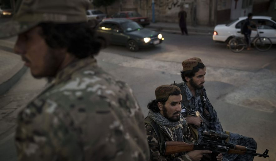 Taliban fighters ride in the back of a pickup truck as patrol the streets of Kabul, Afghanistan, Saturday, Sept. 18, 2021. (AP Photo/Felipe Dana)