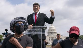 """Joe Kent, a Republican primary candidate for Washington's 3rd Congressional's District, speaks during Justice For J6 rally, near the U.S. Capitol in Washington, Saturday, Sept. 18, 2021. The rally was planned by allies of former President Donald Trump and aimed at supporting the so-called """"political prisoners"""" of the Jan. 6 storming of the U.S. Capitol. (AP Photo/Nathan Howard)"""
