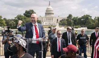 """Matt Braynard, organizer of the Justice For J6 rally, speaks near the U.S. Capitol in Washington, Saturday, Sept. 18, 2021. The rally was planned by allies of former President Donald Trump and aimed at supporting the so-called """"political prisoners"""" of the Jan. 6 insurrection at the U.S. Capitol. (AP Photo/Nathan Howard)"""