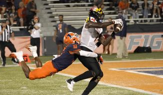 Maryland wide receiver Dontay Demus Jr. catches an initial touchdown pass from quarterback Taulia Tagovailoa as Illinois defensive back Joriell Washington defends during the second half of an NCAA college football game Friday, Sept. 17, 2021, in Champaign, Ill. The play was nullified by an offensive penalty. (AP Photo/Charles Rex Arbogast) **FILE**