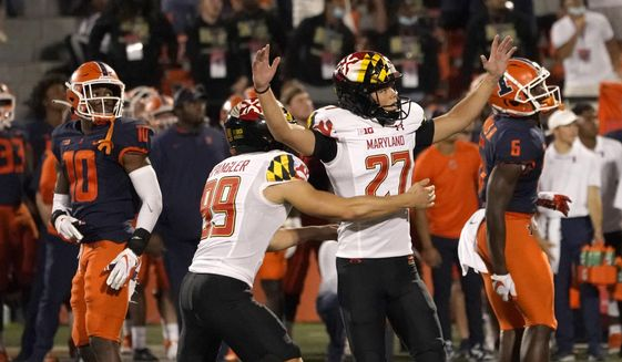 Maryland's Joseph Petrino celebrates his game-winning field goal with holder Colton Spangler during the second half of the team's NCAA college football game against Illinois on Friday, Sept. 17, 2021, in Champaign, Ill. Maryland won 20-17. (AP Photo/Charles Rex Arbogast)