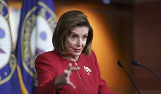 In this Sept. 8, 2021, file photo speaker of the House Nancy Pelosi, D-Calif., meets with reporters to discuss President Joe Biden's domestic agenda including passing a bipartisan infrastructure bill and pushing through a Democrats-only expansion of the social safety net, the at the Capitol in Washington. (AP Photo/J. Scott Applewhite, File)