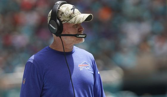Buffalo Bills head coach Sean McDermott looks at the game during the first half of an NFL football game against the Miami Dolphins, Sunday, Sept. 19, 2021, in Miami Gardens, Fla. (AP Photo/Hans Deryk)