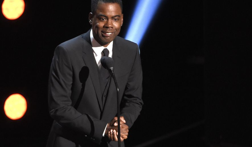"""In this March 30, 2019 file photo, Chris Rock presents the award for outstanding comedy series at the 50th annual NAACP Image Awards at the Dolby Theatre in Los Angeles. Chris Rock on Sunday, Sept. 19, 2021, said he has been diagnosed with COVID-19 and sent a message to anyone still on the fence: """"Get vaccinated.""""  (Photo by Chris Pizzello/Invision/AP, File)"""