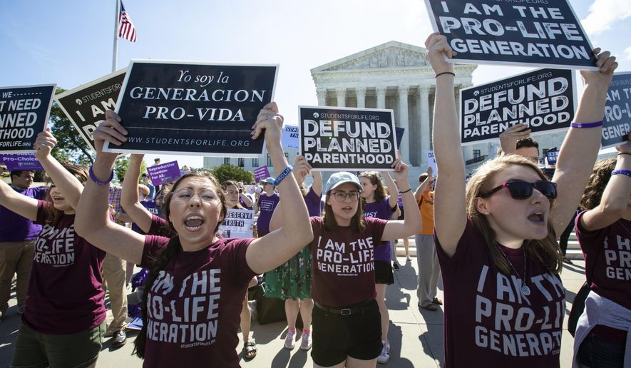 Pro-life and anti-abortion advocates demonstrate in front of the Supreme Court in Washington on June 25, 2018.  (AP Photo/J. Scott Applewhite, File)