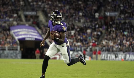 Baltimore Ravens quarterback Lamar Jackson rushes the ball in the second half of an NFL football game against the Kansas City Chiefs, Sunday, Sept. 19, 2021, in Baltimore. (AP Photo/Julio Cortez)