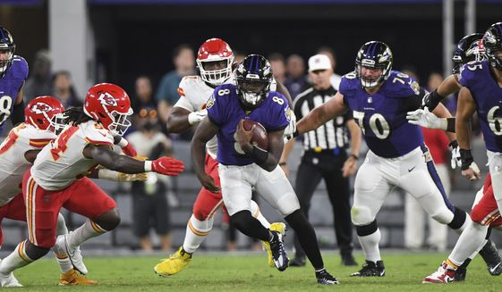 Baltimore Ravens quarterback Lamar Jackson (8) runs the ball during the second half of an NFL football game against the Kansas City Chiefs, Sunday, Sept. 19, 2021, in Baltimore. (AP Photo/Terrance Williams) **FILE**