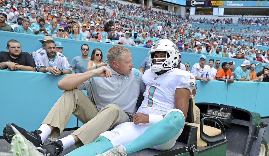 Miami Dolphins quarterback Tua Tagovailoa (1) carted out the field after getting injured in a play during the first quarter of an NFL football game against the Buffalo Bills at Hard Rock Stadium, Sunday, Sept. 19, 2021 in Miami Gardens, Fla. A battery of tests run on Tagovailoa failed to show any serious problems other than bruised ribs, raising at least the possibility that he could play next weekend when the Dolphins (1-1) visit the Las Vegas Raiders (2-0). (David Santiago/Miami Herald via AP) **FILE**