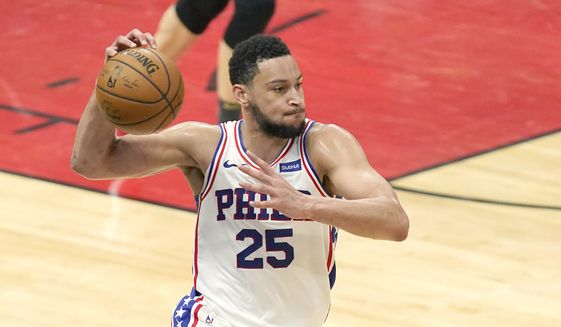 In this May 3, 2021, file photo, Philadelphia 76ers' Ben Simmons looks to pass during the second half of an NBA basketball game against the Chicago Bulls in Chicago. Simmons will not report to Philadelphia 76ers' training camp week and prefers to continue his NBA career with another team, a person with direct knowledge of the player's plans told The Associated Press on Tuesday, Sept. 21, 2021. The person spoke on the condition of anonymity because discussions of Simmons' plans with the franchise have been private. (AP Photo/Charles Rex Arbogast, File) **FILE**