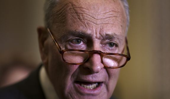 Senate Majority Leader Chuck Schumer, D-N.Y., criticizes Republicans as he speaks to reporters after a weekly policy meeting, at the Capitol in Washington, Tuesday, Sept. 21, 2021. Democratic congressional leaders, backed by the White House, have announced they will push ahead with a vote to fund the government and suspend the debt limit, all but daring Republicans to quit opposing the package or risk a fiscal crisis. (AP Photo/J. Scott Applewhite)