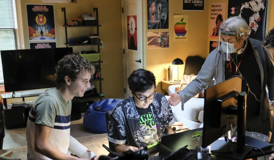 """This mage released by Universal Pictures shows actors Ben Platt, from left, Nik Dodani and director Stephen Chbosky on the set of """"Dear Evan Hansen."""" (Erika Doss/Universal Pictures via AP)"""
