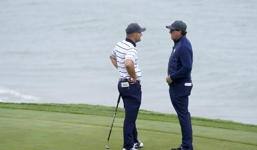 Team USA's Bryson DeChambeau talks to Phil Mickelson on the third hole during a practice day at the Ryder Cup at the Whistling Straits Golf Course Tuesday, Sept. 21, 2021, in Sheboygan, Wis. (AP Photo/Charlie Neibergall) **FILE**