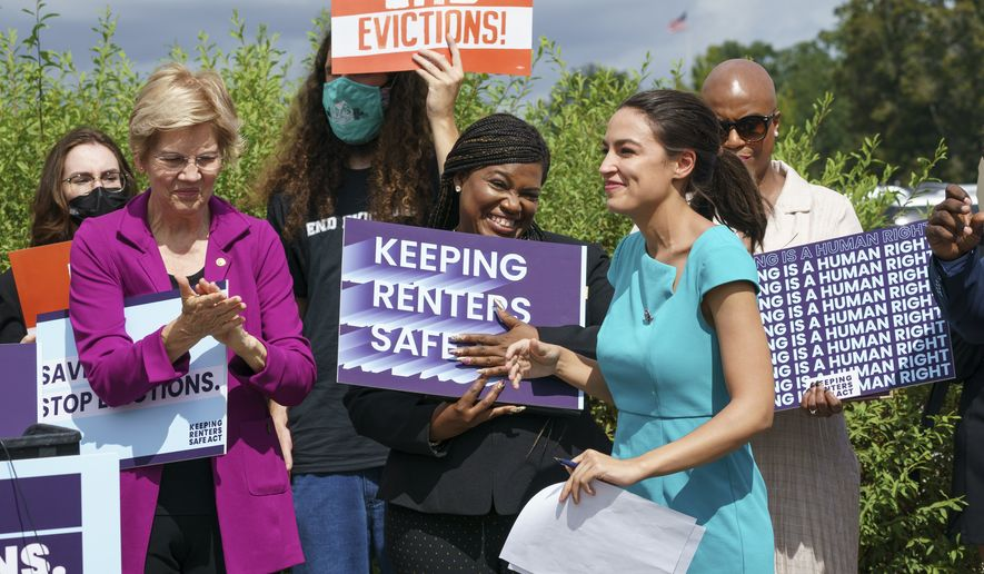 From left, Sen. Elizabeth Warren, D-Mass., Rep. Cori Bush, D-Mo., Rep. Alexandria Ocasio-Cortez, D-N.Y., and Rep. Ayanna Pressley, D-Mass., and other progressive lawmakers advocate for reimposing a nationwide eviction moratorium that lapsed last month, at the Capitol in Washington, Tuesday, Sept. 21, 2021. (AP Photo/J. Scott Applewhite)