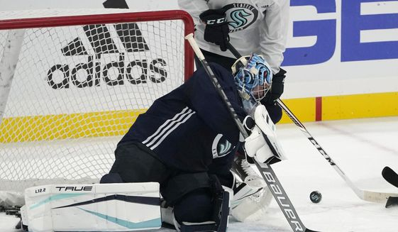 Seattle Kraken goalie Philipp Grubauer watches the puck as he takes part in a practice session, Thursday, Sept. 9, 2021, during a media event for the grand opening of the Kraken's NHL hockey practice and community facility in Seattle. (AP Photo/Ted S. Warren) **FILE**