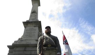 In this July 10, 2017, photo, Cameron Maynard stands at attention by the monument to Confederate soldiers at the South Carolina Statehouse in Columbia, S.C. The South Carolina Supreme Court has upheld a 2000 law protecting Confederate monuments from being moved without a vote from the General Assembly. (AP Photo/Jeffrey Collins) **FILE**