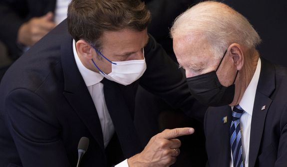 """In this June 14, 2021, file photo, U.S. President Joe Biden, right, speaks with French President Emmanuel Macron during a plenary session during a NATO summit at NATO headquarters in Brussels. Macron expects """"clarifications and clear commitments"""" from Biden in a call to be held later on Wednesday to address the submarines' dispute, Macron's office said. (Brendan Smialowski, Pool via AP, File)"""