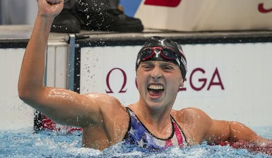Katie Ledecky reacts after winning the women's 1500-meters freestyle final at the 2020 Summer Olympics in Tokyo, in this Wednesday, July 28, 2021, file photo. Ledecky announced Wednesday, Sept. 22, 2021, that she is moving to the University of Florida to be closer to home and train under Anthony Nesty, a rising star coach who will oversee her preparations for the 2024 Paris Olympics. Ledecky, a seven-time Olympic gold medalist, spent the last five years at Stanford University, where she worked with U.S. national team coach Greg Meehan while earning a psychology degree. (AP Photo/Matthias Schrader, File) **FILE**