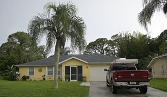 """The home of Brian Laundrie, wanted for questioning in the disappearance of his girlfriend Gabrielle """"Gabby"""" Petito, is viewed, Tuesday, Sept. 21, 2021, in North Port, Fla. (AP Photo/Phelan M. Ebenhack)"""