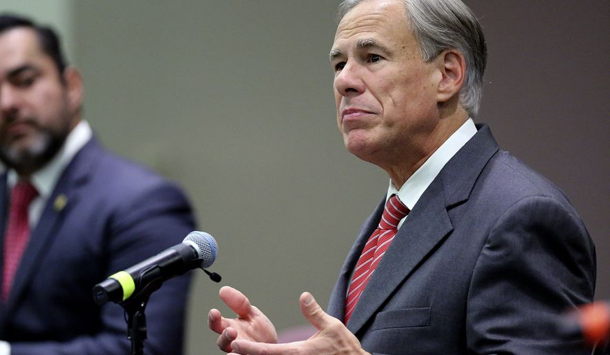 Texas Gov. Greg Abbott speaks before he signs Texas SB 576, an anti-smuggling bill that enhances the criminal penalty for human smuggling when a payment is involved, at McAllen City Hall on Wednesday, Sept. 22, 2021, in McAllen, Texas. (Joel Marinez/The Monitor via AP)