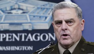 In this Sept. 1, 2021, file photo, Chairman of the Joint Chiefs of Staff Gen. Mark A. Milley speaks during a briefing with Secretary of Defense Lloyd Austin at the Pentagon in Washington. The top U.S. military officer met with his Russian counterpart Wednesday, Sept. 22, 2021, against the backdrop of U.S. struggles to get military basing rights and other counterterrorism support in countries bordering Afghanistan — a move Moscow has flatly opposed. (AP Photo/Susan Walsh, File)