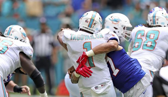 Miami Dolphins quarterback Tua Tagovailoa (1) is sacked by Buffalo Bills defensive end A.J. Epenesa (57) during the first quarter of an NFL football game Sunday, Sept. 19, 2021, in Miami Gardens, Fla. A battery of tests run on Tagovailoa failed to show any serious problems other than bruised ribs, raising at least the possibility that he could play next weekend when the Dolphins (1-1) visit the Las Vegas Raiders (2-0). (David Santiago/Miami Herald via AP) **FILE**