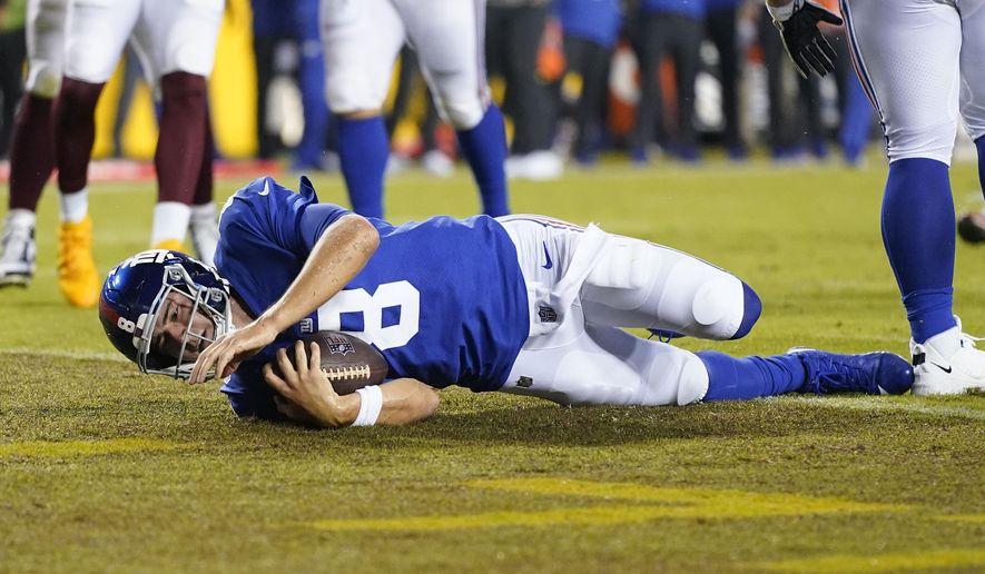 New York Giants quarterback Daniel Jones (8) scoring a touchdown against the Washington Football Team during the first half of an NFL football game, Thursday, Sept. 16, 2021, in Landover, Md. (AP Photo/Patrick Semansky) **FILE**