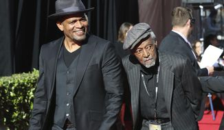"""Mario Van Peebles, from left and Melvin Van Peebles arrive at the screening of """"The Producers"""" at the 2018 TCM Classic Film Festival Opening Night at the TCL Chinese Theatre on Thursday, April 26, 2018, in Los Angeles. Melvin Van Peebles, a Broadway playwright, musician and movie director whose work ushered in the """"blaxploitation"""" films of the 1970s, has died at age 89. His family said in a statement that Van Peebles died Tuesday night, Sept. 21, 2021, at his home. (Photo by Willy Sanjuan/Invision/AP, File)"""