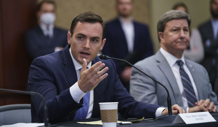 Rep. Mike Gallagher, R-Wis., left, a former Marine, joined at right by Rep. Mike Rogers, R-Ala., ranking member of the House Armed Services Committee, speaks during a roundtable discussion with House Minority Leader Kevin McCarthy, R-Calif., and other Republicans as they criticize President Joe Biden on the Afghanistan evacuation, at the Capitol in Washington, Monday, Aug. 30, 2021. (AP Photo/J. Scott Applewhite)