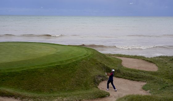 Team USA's Xander Schauffele hits to the third green during a practice day at the Ryder Cup at the Whistling Straits Golf Course Thursday, Sept. 23, 2021, in Sheboygan, Wis. (AP Photo/Jeff Roberson) **FILE**