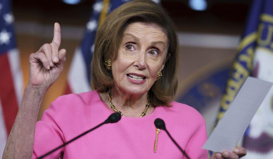 "Speaker of the House Nancy Pelosi, D-Calif., updates reporters on Democratic efforts to pass President Joe Biden's ""Build Back Better"" agenda, at the Capitol in Washington, Thursday, Sept. 23, 2021. (AP Photo/J. Scott Applewhite)"