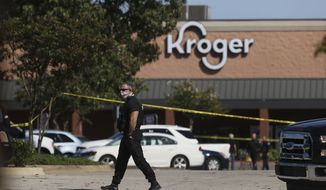 Police respond to the scene of a shooting at a Kroger's grocery store in Colliersville, Tenn, on Thursday, Sept. 23, 2021. (Joe Rondone/The Tennessean via AP)