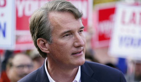 Virginia Republican gubernatorial candidate Glenn Youngkin speaks with members of the press after voting early, Thursday, Sept. 23, 2021, in Fairfax, Va. (AP Photo/Patrick Semansky)