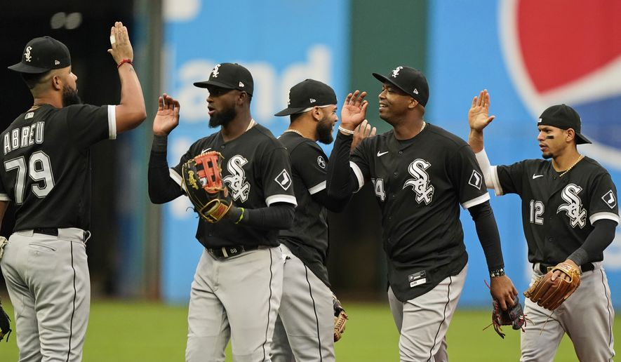 The White Sox celebrate after clinching the American League title after defeating the Cleveland Indians 7-2 in the first baseball game of a doubleheader, Thursday, Sept. 23, 2021, in Cleveland. (AP Photo/Tony Dejak)