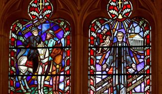 This Wednesday, Sept. 6, 2017, file photo shows stained glass windows depicting two Confederate generals at the Washington National Cathedral. Washington National Cathedral has chosen contemporary artist Kerry James Marshall, renowned for his wide-ranging works depicting African American life, to design new stained-glass windows with themes of racial justice to replace windows with Confederate imagery that were removed from the landmark sanctuary in 2017. (AP Photo/Carolyn Kaster)
