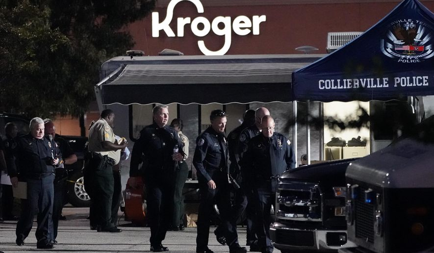 Law enforcement personnel work in front of a Kroger grocery store as an investigation goes into the night following a shooting earlier in the day on Thursday, Sept. 23, 2021, in Collierville, Tenn. Police say a gunman attacked people in the store and killed at least one person and wounded 12 others before the suspect was found dead. (AP Photo/Mark Humphrey)