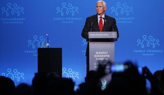 """Former US Vice President Mike Pence holds a speech during the 4th Budapest Demographic Summit in Budapest, Hungary, Thursday, Sept. 23, 2021. The biannual demographic summit, which was first organized in 2015, offers a forum for """"pro-family thinker"""" decision-makers, scientists, researchers, and church representatives of the same sort to exchange their thoughts about connections between demographics and sustainability. (AP Photo/Laszlo Balogh)"""