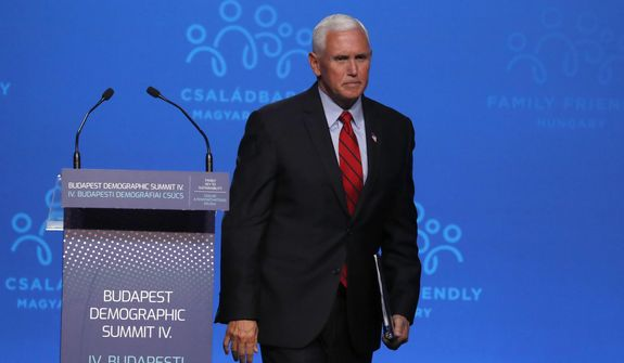 """Former US Vice President Mike Pence after holding a speech during the 4th Budapest Demographic Summit in Budapest, Hungary, Thursday, Sept. 23, 2021. The biannual demographic summit, which was first organized in 2015, offers a forum for """"pro-family thinker"""" decision-makers, scientists, researchers, and church representatives of the same sort to exchange their thoughts about connections between demographics and sustainability. (AP Photo/Laszlo Balogh)"""