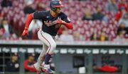 Washington Nationals' Juan Soto runs to first after hitting a single against the Cincinnati Reds during the second inning of a baseball game Thursday, Sept. 23, 2021, in Cincinnati. (AP Photo/Jay LaPrete)
