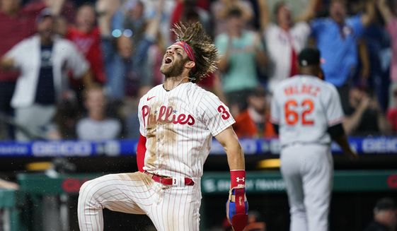 Philadelphia Phillies' Bryce Harper celebrates after scoring the game-winning run on a two-run triple by J.T. Realmuto during the 10th inning of an interleague baseball game against the Baltimore Orioles, Tuesday, Sept. 21, 2021, in Philadelphia. (AP Photo/Matt Slocum) **FILE**