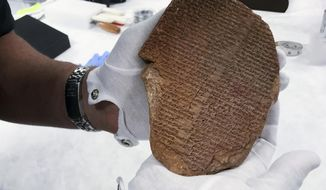 This undated image provided by the U.S. Immigration and Customs Enforcement's office of public affairs shows a 3,500-year-old artifact, known as the Gilgamesh Dream Tablet. The tablet contains a portion of the Epic of Gilgamesh, considered one of the earliest surviving works of notable literature. (U.S. Immigration and Customs Enforcement via AP)
