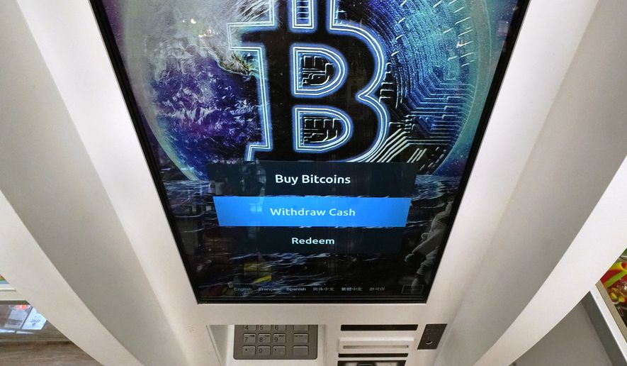 In this Feb. 9, 2021, file photo, the Bitcoin logo appears on the display screen of a cryptocurrency ATM at the Smoker's Choice store in Salem, N.H.  (AP Photo/Charles Krupa, File)   **FILE**