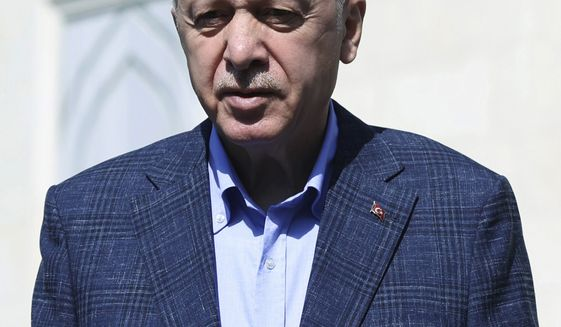 Turkish President Recep Tayyip Erdogan speaks to the media after Friday prayers, in Istanbul, Friday, Sept. 24, 2021. Erdogan said Friday that recent talks with U.S. President Joe Biden had proved disappointing, and that his country, a NATO member, would seek closer ties with Russia. Erdogan said he and Biden had failed to bridge their differences at a meeting during his visit to New York for the UN General Assembly earlier on in week. (Turkish Presidency/Pool Photo via AP)