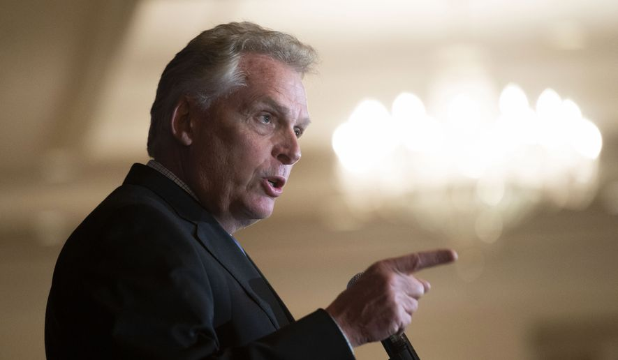 In this Wednesday, Sept. 1, 2021, file photo, Virginia Democratic gubernatorial candidate Terry McAuliffe addresses the Virginia FREE Leadership Luncheon in McLean, Va. (AP Photo/Cliff Owen, File)