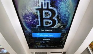 In this Feb. 9, 2021, file photo, the Bitcoin logo appears on the display screen of a cryptocurrency ATM at the Smoker's Choice store in Salem, N.H. China's central bank on Friday, Sept. 24, 2021, declared all transactions involving Bitcoin and other virtual currencies illegal, stepping up a campaign to block use of unofficial digital money. (AP Photo/Charles Krupa, File)