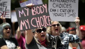 A group gathers to protest abortion restrictions at the State Capitol in Austin, Texas, Tuesday, May 21, 2019. Abortion rights advocates say the pandemic has demonstrated the value of medical care provided virtually, including the privacy and convenience of abortion taking place in a woman's home, instead of a clinic. (AP Photo/Eric Gay) **FILE**